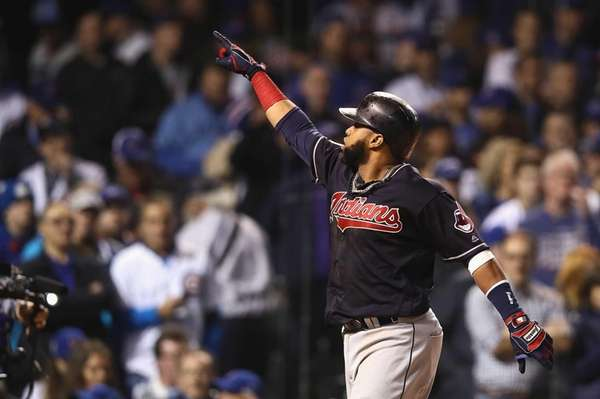 Carlos Santana of the Cleveland Indians celebrates after
