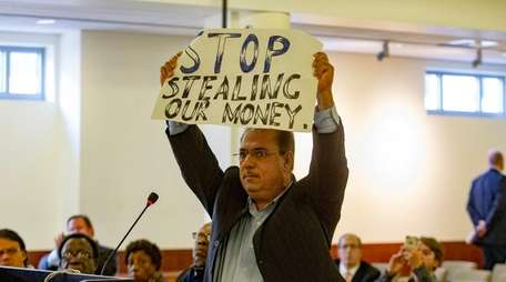 Valley Stream resident Malik Amid expresses displeasure with
