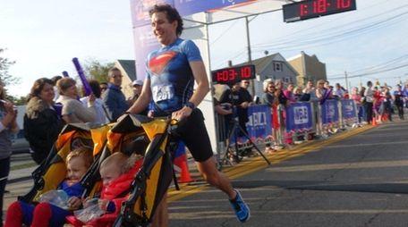 Chris Solarz, of Manhattan, breaks a Guinness World