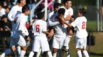 Amityville celebrates Marlon Martinez's first of two goals