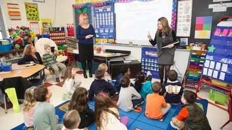 Kindergarten teachers Jenn Chernis, left, and Christie Clay