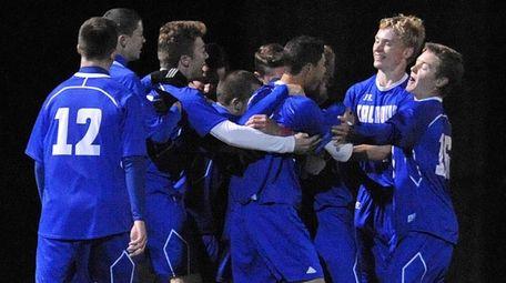 Calhoun teammates celebrate after a goal in the