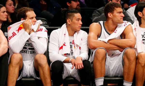 Bojan Bogdanovic, Jeremy Lin and Brook Lopez of