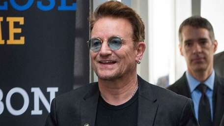 Bono arrives at the Global Fund conference in