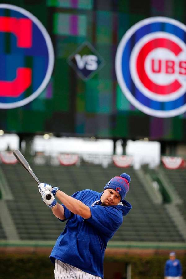 Chicago Cubs' Kyle Schwarber stretches works out during