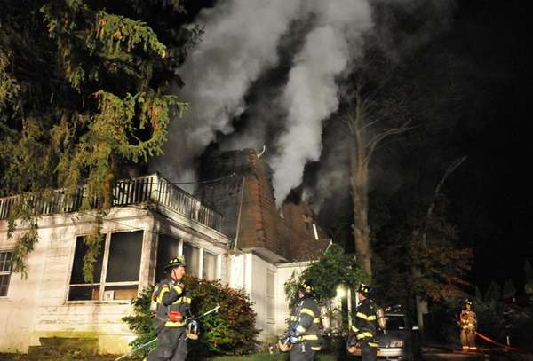 Firefighters fight a blaze at a house on