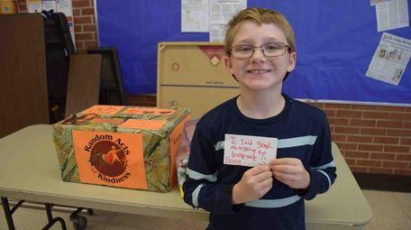 Sixth-grader Denis Charland shares his kindness card at