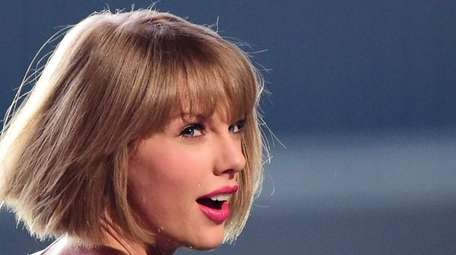 Taylor Swift performs on stage during the 58th