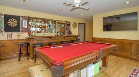 The bar in this four-bedroom Brookhaven ranch has