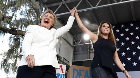 Hillary Clinton greets supporters with former Miss Universe