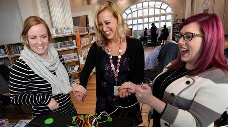 Librarians, Charlotte Latuso, Michele Cayea, and Colleen Hutchens,