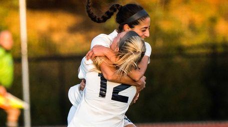 Northport's Victoria Colatosti celebrates with teammates after scoring