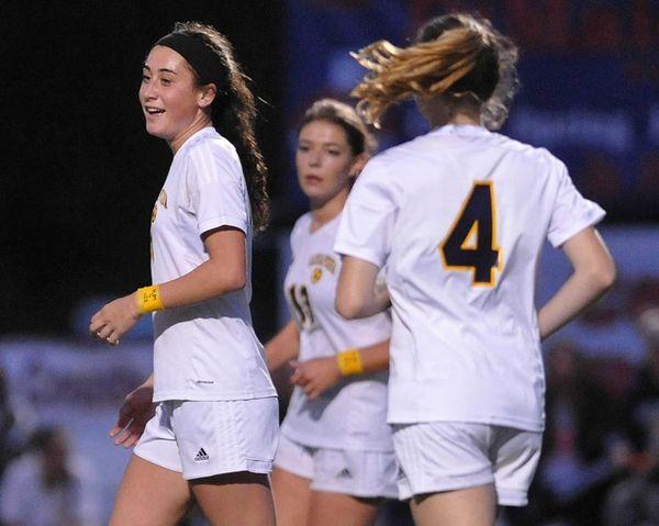 Hope Breslin #11 of Massapequa reacts after scoring