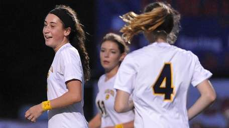 Hope Breslin #11 of Massapequa reacts after scoring
