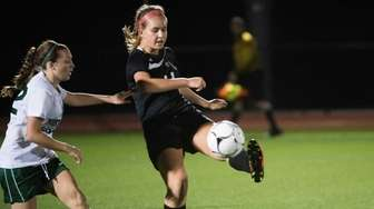 Mt. Sinai's Casey Schmitt controls the ball against