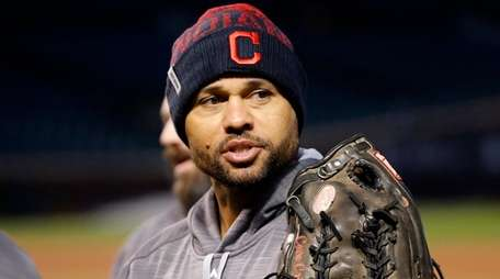 Cleveland Indians' Coco Crisp rests his gloves on
