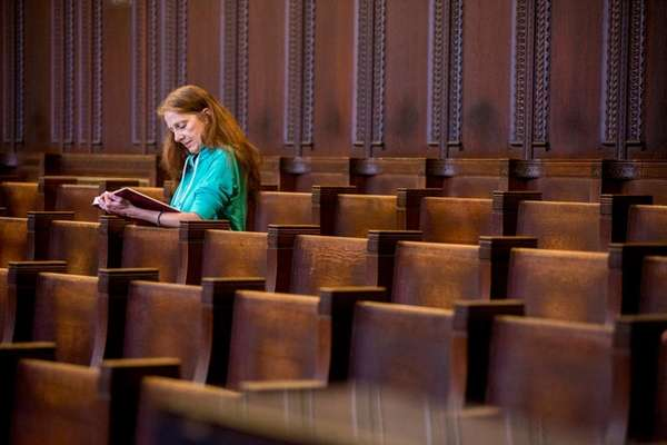 A woman in prayer at the Seminary of