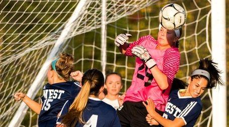 Northport goalie #29 Emma Havrilla makes a save