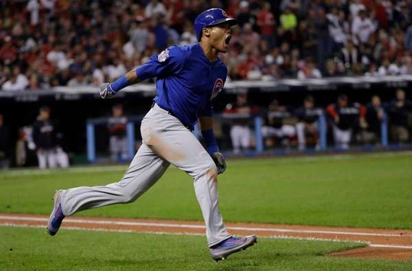 Chicago Cubs' Addison Russell celebrates after hitting a