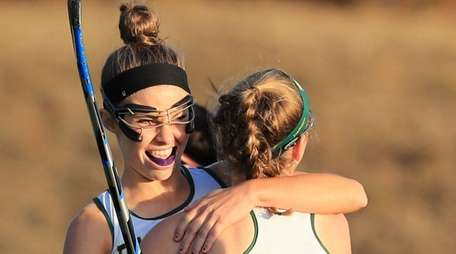 Ward Melville's Kate Mulham is congratulated by Kerri