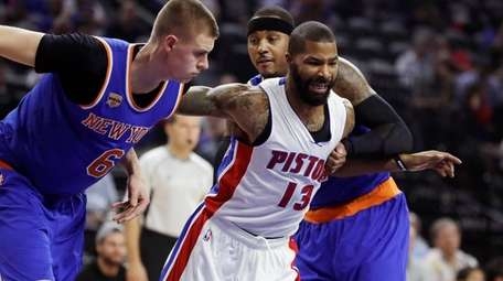 Detroit Pistons forward Marcus Morris fights for position