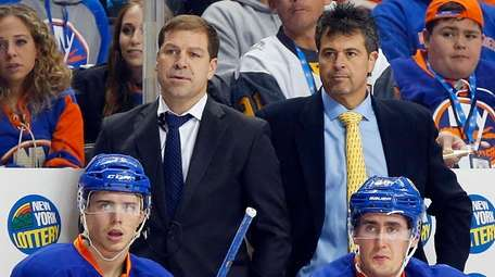 Head coach Jack Capuano, assistant coach Doug Weight,