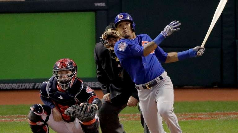 Cubs' Addison Russell watches his grand slam against