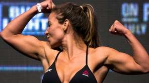 Miesha Tate poses for photographers during the UFC