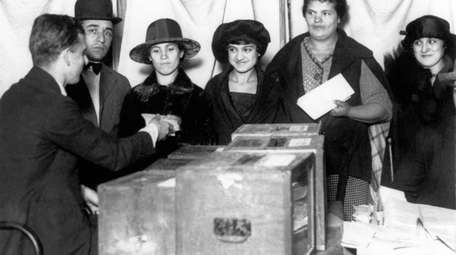 Women line up to vote for the first