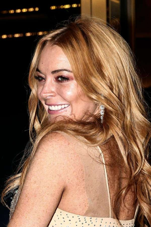 Lindsay Lohan attends the opening of her new