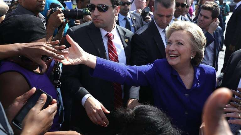 Democrat Hillary Clinton greets voters at an early