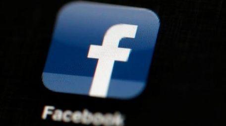 A Facebook logo is displayed on an iPad