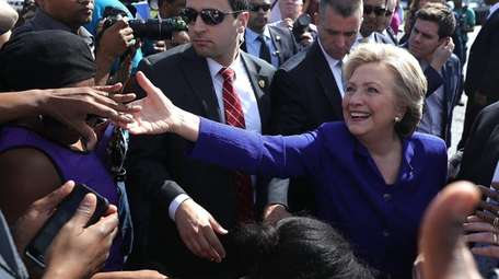 Hillary Clinton makes her way through a crowd