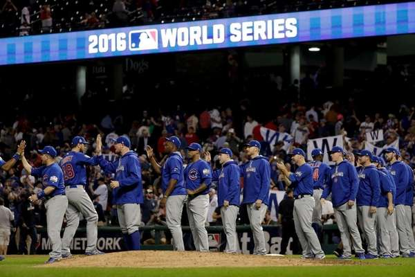 The Chicago Cubs celebrate after their win in