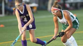 Carle Place's Alexis Ruiz (1) and Oyster Bay's