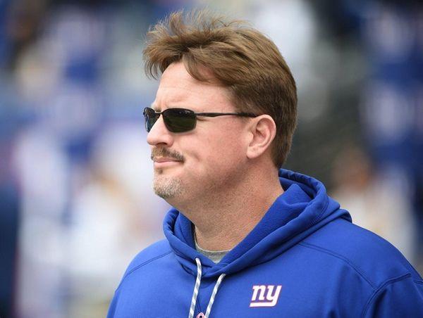 New York Giants' head coach Ben McAdoo walks