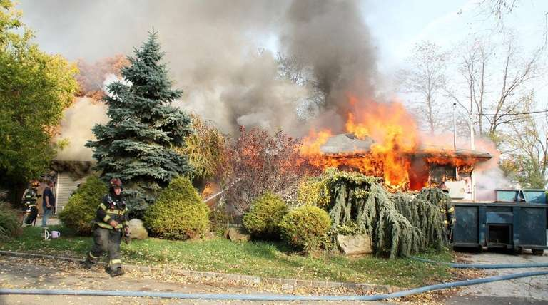 About 70 firefighters battled flames on Wednesday, Nov.