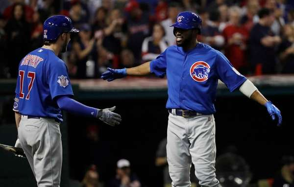 Chicago Cubs' Dexter Fowler celebrates with Kris Bryant