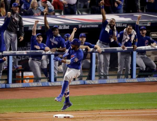 Chicago Cubs' Dexter Fowler celebrates after a home