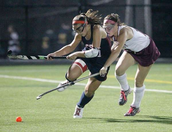 Garden City's Julianne Larsson (10) and Cold Spring
