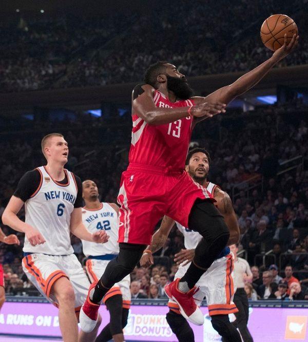 Houston Rockets guard James Harden (13) goes to