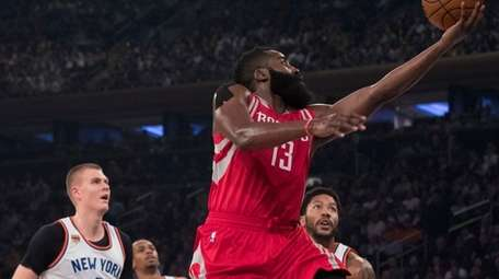 Houston Rockets guard James Harden (13) goes to