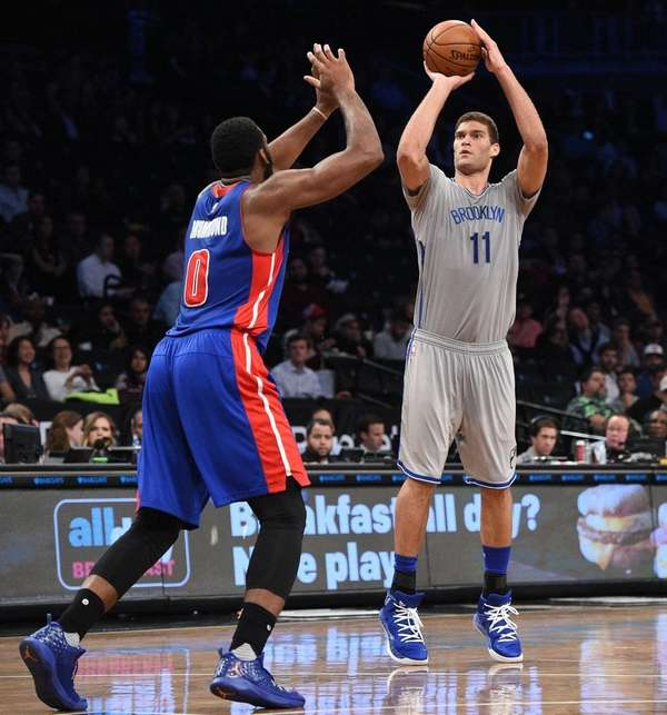 Brooklyn Nets center Brook Lopez sinks a three-point