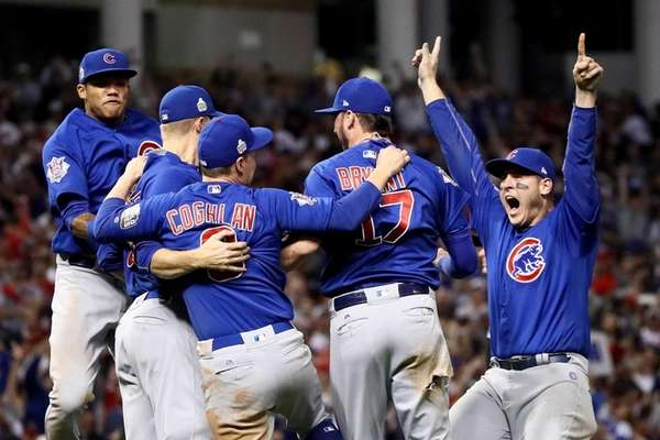 The Chicago Cubs celebrate after defeating the Cleveland