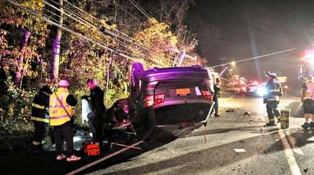 A vehicle overturned on Middle Country Road in