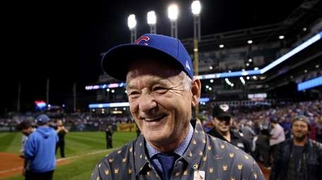 Actor Bill Murray reacts on the field after