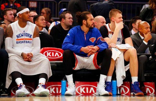 Carmelo Anthony #7, Joakim Noah #13 and Kristaps