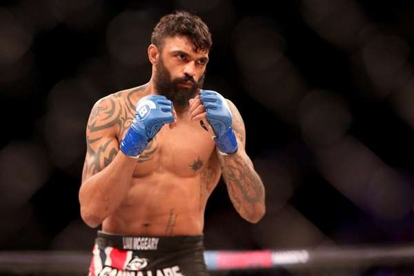 Liam McGeary in action against Emanuel Newton during