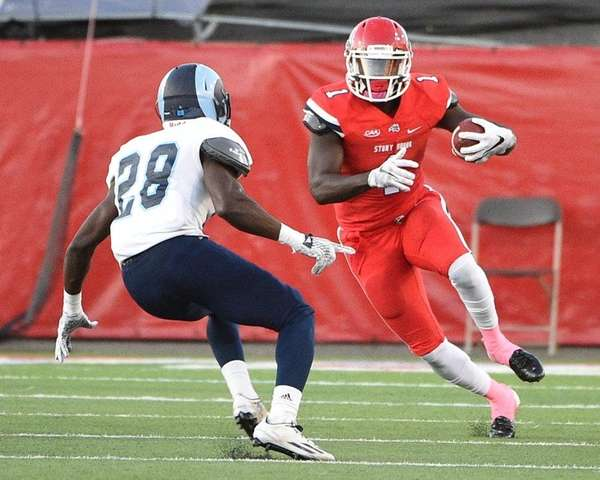 Stony Brook wide receiver Tim Keith carries the