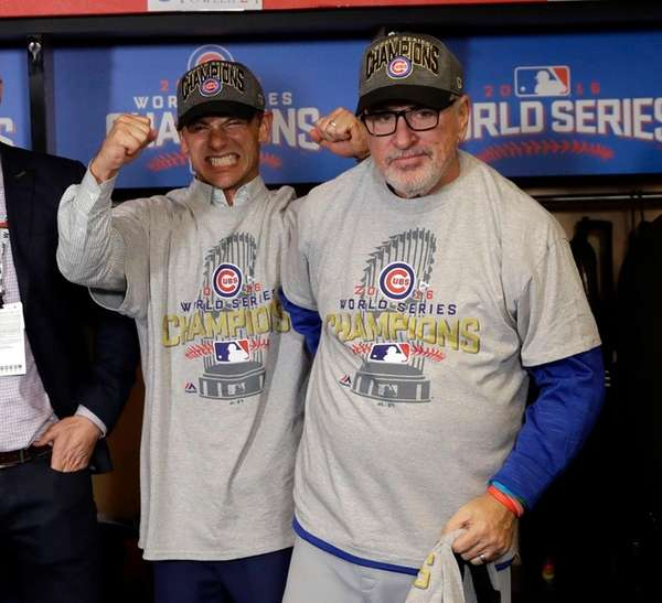 Chicago Cubs general manager Jed Hoyer, left, and